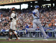 Kansas City Royals Alcides Escobar runs past San Francisco Giants catcher Buster Posey to score on a ground out by Lorenzo Cain during the first inning of Game 3 of baseball's World Series between the Kansas City Royals and the San Francisco Giants Friday, Oct. 24, 2014, in San Francisco. (AP Photo/Matt Slocum)