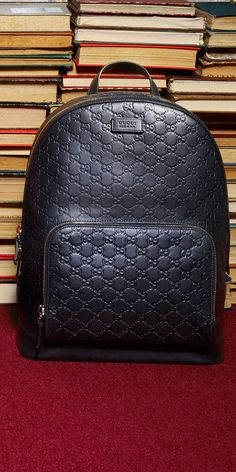 2060e834745e Gucci Men - Gucci Signature leather backpack - Shop at Stylizio for luxury  designer handbags