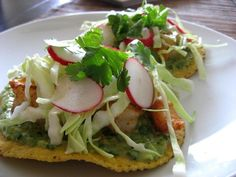 RECIPE: SHRIMP TOSTADAS WITH AVOCADO VERDE.  These grilled chili lime shrimp are awesome and are straight off the Mexican coast.  Crunchy, healthy, and delicious.  They are accentuated by a bright and refreshing avocado salsa verde.  Nice!