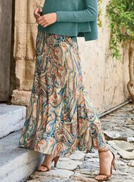 Watercolor paisleys form a swirling canvas in sun-washed hues of chambray, poppy, teal, russet and parchment. The graceful viscose (95%) and elastane (5%) jersey maxi-skirt has a contoured yoke and sweeping A-line hem.