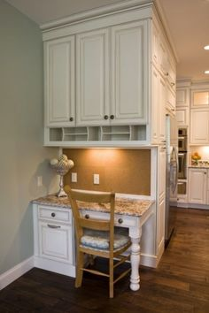 cabinet style & color, cabinets to ceiling, storage area for bills & papers, cork backing, small desk area for kids homework