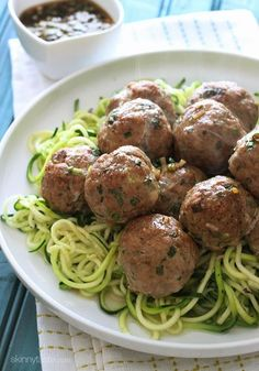 Asian Turkey Meatballs With Lime Sesame Dipping Sauce. YUMMMMMMMM! Healthy never looked so good! And on a bed of zucchini noodles no less! Awesome.