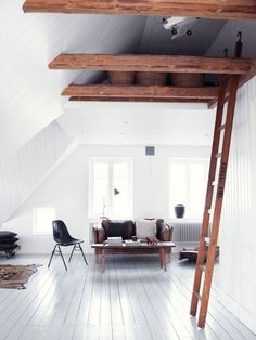 I think I'm in love with exposed beams up high within a house. I'd want mine to be grey though.