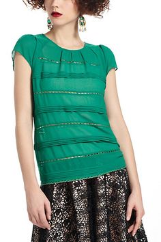 I like this green top....looks warm (it's silk) and comfortable.