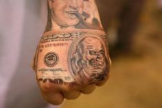 Tattoos by Jose Lopez & Lowrider Tattoo Studio. A man never without money.