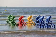 Art Installation The Escape (De ontsnapping) by Erik Nagels for the 100th edition of the Tour the France. Ostend, Belgium, cycling country. Artwork in sea.