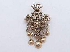 Heraldic Shield brooch with Crown top and dangles AL17 by MeyankeeGliterz on Etsy
