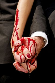 This picture represents how Macbeth and Lady Macbeth are both equally as guilty with the murder of Duncan as the picture shows both people with bloody hands. Although, Lady Macbeth did not commit the murder, she spurred Macbeth on to do it therefore she shares just as much of the blame as Macbeth.