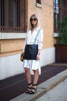 10 skirt and shirt combos that you need to try now: Striped shirt dress and leather mini skirt seen in street style