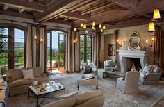 Luxury living room in Tuscan style home with ocean views.