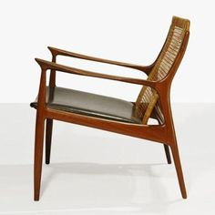 Torbjorn Afdal; Teak, Cane and Leather Armchair, 1960s.