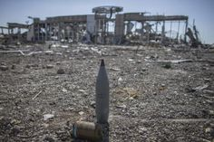 Unexploded ordnance is seen at the destroyed airport in Luhansk, eastern Ukraine, September 14, 2014.  REUTERS/Marko Djurica