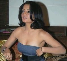 Bollywood actress snapped while she adjusts top blue costume to cover her boobs thereby exposing her lining ----- CELINA JAITLEY -----