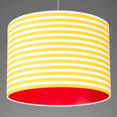 Pick and mix stripes lampshade with yellow and white fabric and red lining