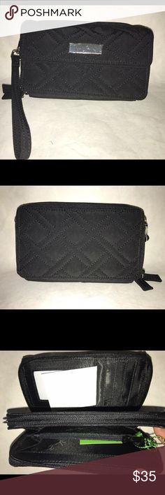Vera Bradley Black Microfiber All in One Crossbody Vera Bradley Black Microfiber All in One Crossbody and Wristlet for iPhone 6+ NWT! It has a long removable strap and removable wristlet strap. It has a front pocket with a magnetic flap big enough to hold your iPhone 6+. There are two zippered compartments, one with two slip in pockets and a zippered coin purse and the other with a bill holder, 8 credit card slots, and a clear id window. This comes from a smoke free home! Vera Bradley Bags…