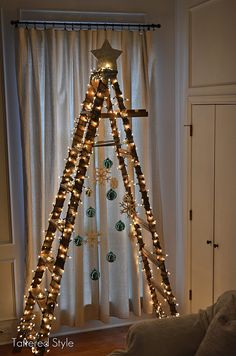 Now I know what to do with the ladders in my back flower garden. Ladder Christmas Tree