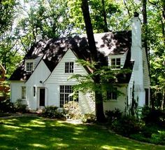 White cottage in the woods plus a white picket fence and flowers is the exterior of my dream house!