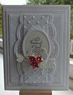 I have used Spellbinders Grand rectangles, Spellbinders A2 scalloped borders, Spellbinder classic ovals large, marianne designs (leaf) justrite hugs and kisses stamp, Sue Wilson heart lattice embossing folder, flowers from Wild orchid crafts.
