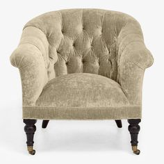 With a grand tufted back and curved arms, black walnut finished legs are accompanied by wheel and caster feet. Velvet in Rome Pecan is sensual and versatile. Available as a sofa.<br /><br />Choose from our curated color or customize your own by selecting a Special Order color from the swatches above. Additional fabric and size options are available in-store.