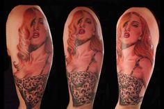 colour tattoo upperarm sexy redhead pinup girl bombshel leopard print