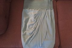 Catherine Malandrino high waisted teal tulip skirt size 6. Rent now for $25/week