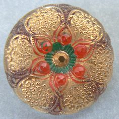 Lacy gold touched reverse painted clear Czech glass button