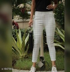 Active Bottomwear Trendy Fashionable Cotton Jegging  *Fabric* Cotton  *Size* Up 26 in To 34 in ( Free Size )  *Length* Up To 39 in  *Type* Stitched  *Description* It Has 1 Piece Of Jegging  * Work * Checkered  *Sizes Available* 28, 30, 32, 34, 36 *   Catalog Rating: ★3.9 (738)  Catalog Name: Eva Trendy Fashionable Cotton Jeggings CatalogID_243123 C79-SC1408 Code: 992-1847564-