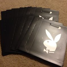 """13 Playboy bunny bags! These bags are made out of paper. Black bags with white symbols. The dimensions are 2.5"""" x 7"""" x 10"""". They are great for parties or to give as part of gifts. Fun, fun, fun! They are new and never been used. Playboy Bags Mini Bags"""