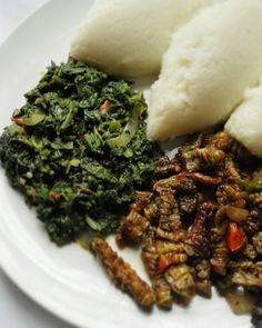 Zambian Lunch. Nshima with pumpkin leaves and mopani worms. African food. Zambia