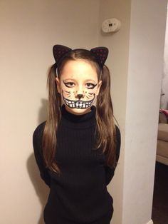 Evil Halloween Cheshire Cat face paint idea for girls