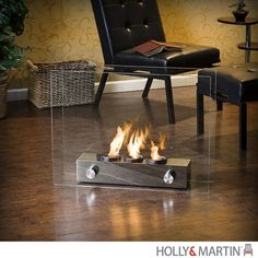 Sheer modern elegance wrapped up in a unique portable gel fireplace. Floating glass panels are held in place by a brushed nickel base that houses up to 3 cans of FireGlo gel fuel with output up to BTU each. Portable and great for indoor and outdoor use. Gel Fireplace, Fireplace Design, Small Fireplace, Fireplace Ideas, Bioethanol Fireplace, Fireplace Inserts, Fireplace Mantels, Portable Fireplace, Indoor Outdoor Fireplaces