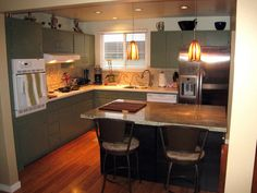 granite for 150 bucks and cut a cutting board to fit the hole where a sink would go    Ready to transform your kitchen, but don't want to spend a fortune? Check out these stylish, yet inexpensive spaces from fellow DIYNetwork.com users.