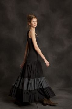 Look at the lines on this dress. Long slimming lines down to hip, and then the gathered skirt layer is on TOP of the slim line.