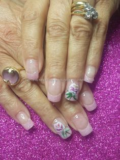 Pink glitter acrylic tips with one stroke flower nail art