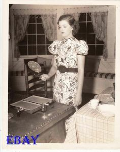"Myrna Loy makes pancakes on the set of ""Libeled Lady"""