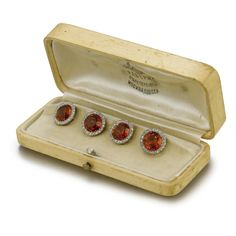 A Set of Four Fabergé Diamond and Citrine Buttons, St. Petersburg, circa 1900, each faceted citrine button with a border of diamonds. Also with later gold bars by Krementz & Company added for use as dress studs. Provenance: Friedrich Meding (1879-1965), Thence by descent.