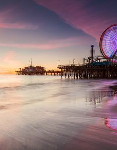 Watch the sunset at Santa Monica Pier-someplace far, far away from here & peaceful with happy people.