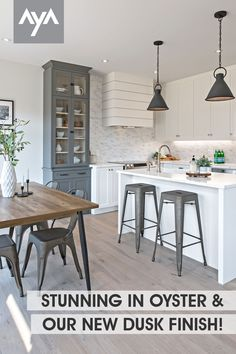 A stunning collaboration by our friends London Kitchen Studio + Rockmount Homes, this Transitional duo tone AyA kitchen features our NEW Dusk painted finish along with Oyster. A neutral grey sure to make a statement in any living space. Shiplap range, countertop to ceiling backsplash and the gorgeous hutch with Avenza interiors, we love this space. Read all about our new Dusk finish at ayakitchens.com Studio Kitchen, Kitchen Design, Duo Tone, Kitchen And Bath, Oysters, Dusk, Backsplash, Collaboration, Countertops