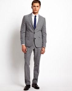 In neutral colors, suits with a slim fit look great paired with dress shoes and colorful shirts. Showcase your incredible personality, while still being stylish, with a suit that fits you just the way that you like. At the office, slim fit suits are a great choice. Look professional and put together with a .