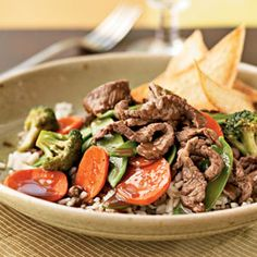 Sirloin and Vegetable Stir-Fry Recipe- Lean beef is an ideal source of protein, and stir-frying is a quick and easy cooking method. Healthy carbohydrates from rice, and fiber from fresh veggies make this meal perfect after a strength workout.