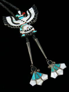 Hand Made Old Pawn Indian Jewelry Sterling Silver Zuni Inlay Bolo This eagle dancer bolo is inlaid with turquoise, mother of pearl, coral, abalone and jet in sterling silver. Includes matching inlaid tips. There are no visible artist markings. It has not been cleaned
