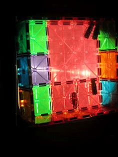 hexbug nano's on the overhead projector with a cage build of magna tiles