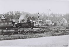 Teralba Railway Station, Lake Macquarie, NSW, looking north-west. Passenger train with steam engine. Taken beore 1910 [no overhead railway bridge] St Michaels Catholic Church in background, right hand side.