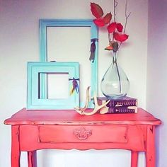 White walls with bright colored accents make a perfect combination! This table is painted with Farmhouse Paint Caribbean Coral and topped with Teastain Antiquing Gel, and the frames are painted in Farmhouse Paint Turquoise Toulouse.