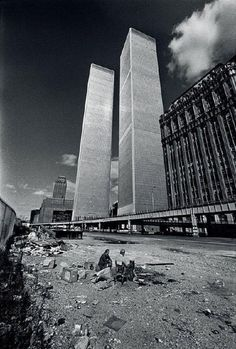 """wandrlust: """" World Trade Center, New York City, October, 1975 — Jean-Pierre Laffont """" Two homeless men squat in the shadow of the recently completed World Trade Center. New York City was on the verge. Old Pictures, Old Photos, Amazing Pictures, New York Vintage, Photographie New York, New York City, World Trade Center Nyc, Trade Centre, Photo New York"""