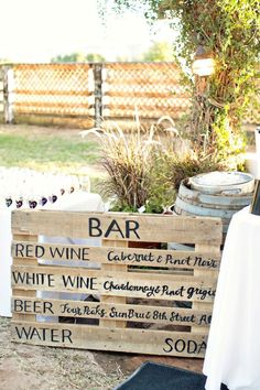 kegs in wine barrels, mason jars, and pallet menus
