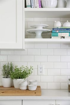 """BACKSPLASH 3x6 white subway tiles from Home Depot We used Flextile grout in Bone and went with 1/16"""" spacers when installing the tile"""