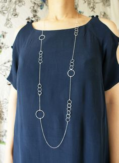 Silver Circles Long Necklace - sterling silver hand hammered circles modern simple long necklace. $126.50, via Etsy.
