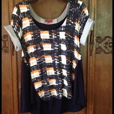 Anthropologie Mixed Media Tee This funky and fun top from Anthropologie has a hi lo cut with seersucker rolled sleeves and asymmetrical panel in the back. Plaid-ish watercolor design in navy and oranges make this a fresh alternative to a basic tee. Has a casual chic vibe! Anthropologie Tops Tees - Short Sleeve