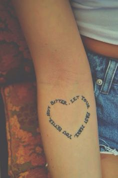 Very beautiful quote in heart tattoo form giving a positive meaning
